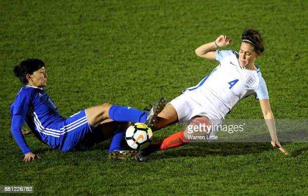 Fara Williams of England tackles Begaim Kirgizbaeva of Kazakhstan during the FIFA Women's World Cup Qualifier match between England and Kazakhstan at...