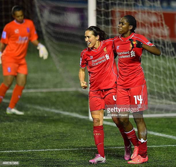 Fara Williams of Liverpool Ladies celebrates with Asisat Oshoala after scoring a goal during the WSL match between Liverpool Ladies and Birmingham...