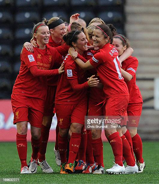 Fara Williams of Liverpool Ladies FC is congratulated by her team-mates after scoring her side's second goal during the FA WSL match between...