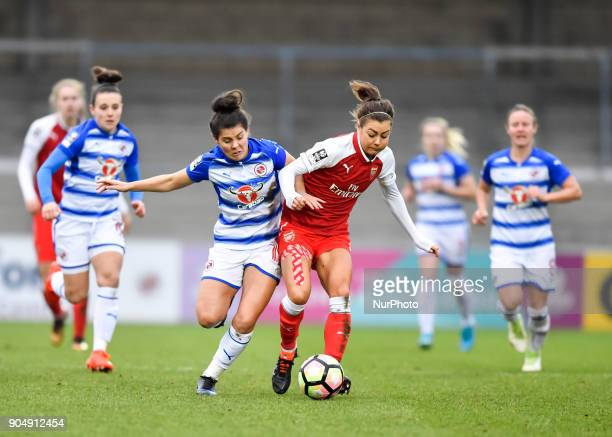 Fara Williams of Reading FC Women battles for possession with Jemma Rose of Arsenal during Continental Tyres Cup semifinals match between Reading FC...