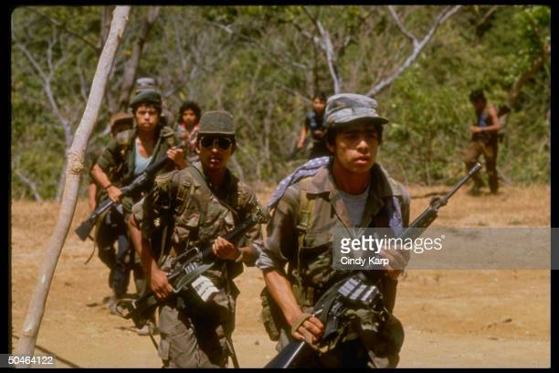 Farabundo Marti National Liberation Front guerrillas on a training drill in the Usulutan province of western El Salvador.
