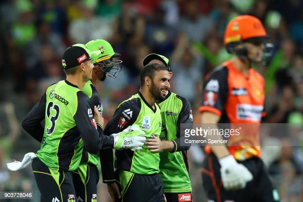 Farad Ahmed of the Thunder celebrates after taking the wicket of Adam Voges of the Scorchers during the Big Bash League match between the Sydney...