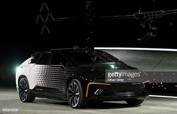 Faraday Future's FF 91 prototype electric crossover vehicle is shown during a speed test as it is unveiled during a press event for CES 2017 at The...