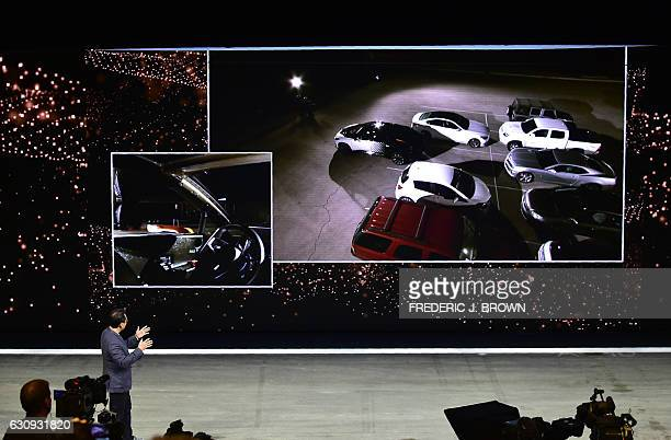 Faraday Future's Hong Bae Director if ADAS Self Driving gestures while giving the audience a live display on the screen of a selfdriving and parking...