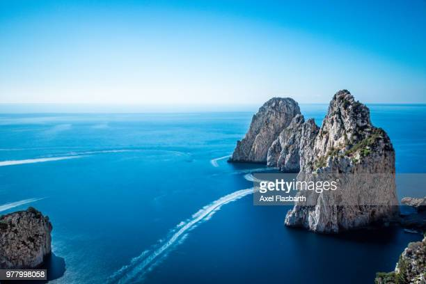 faraglioni of capri, capri, campania, italy - capri stock pictures, royalty-free photos & images