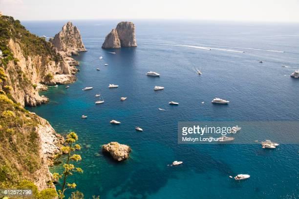 faraglioni rocks and coastline, capri, italy - capri stock pictures, royalty-free photos & images