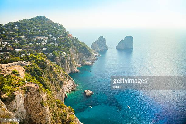 faraglioni rocks - natural landmark of capri island in italy. - capri stock pictures, royalty-free photos & images