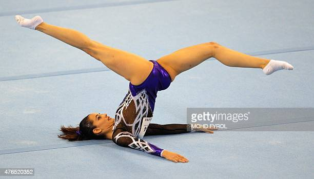 Farah Ann Abdul Hadi of Malaysia competes during the women's floor excercise routine final at the 28th Southeast Asian Games in Singapore on June 10...