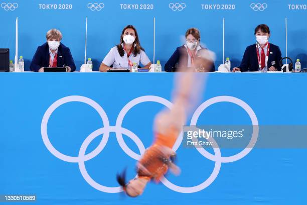 Farah Ann Abdul Hadi of Team Malaysia competes in the floor exercise as judges look on during Women's Qualification on day two of the Tokyo 2020...