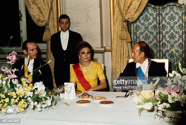 Farah Diba Empress of Iran sits among French diplomats at the Institut de France where she is to meet architect Eugene Baudoin The Iranian empress is...