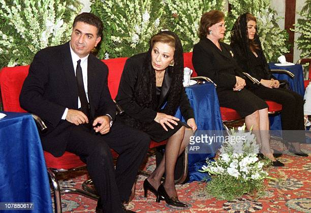 Farah Diba the widow of Reza Pahlavi the last Shah of Iran listens to verses from the Koran 26 July 2000 during a ceremony marking the 20th...