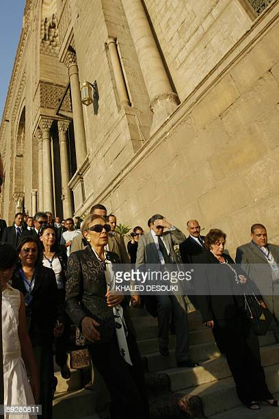 Farah Diba widow of the late Shah of Iran Mohammad Reza Pahlavi and Jihan Sadat widow of Egypt's assassinated former president Anwar Sadat attend a...