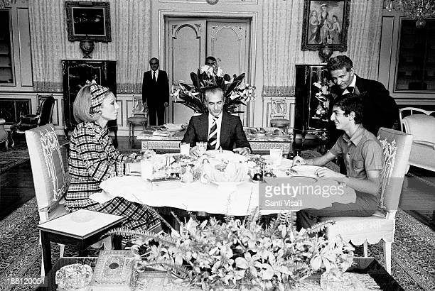 Farah DibaShah of IranPrince Ciro having lunch on June 15 1977 in Tehran Iran