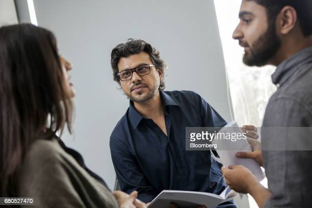 Faraz Khan cofounder and chief executive officer of Seed Ventures listens to an employee at his office in Karachi Pakistan on Monday April 24 2017...