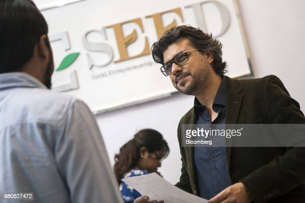 Faraz Khan cofounder and chief executive officer of Seed Ventures speaks to an employee at his office in Karachi Pakistan on Monday April 24 2017...