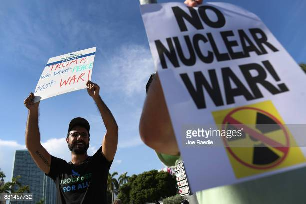 Farbod Tehranian joins other protesters gathered to ask President Donald Trump to stop his drive to war against North Korea on August 14 2017 in...