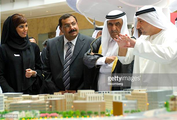 Fareed Abdulrahman right executive director of Smart City explains to Sheikh Hamdan bin Rashid Al Maktoum and Tark Kamal center right and Egypts...