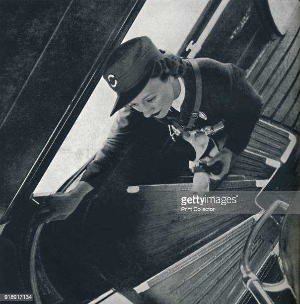 'Fares please' 1941 A bus conductress on the London buses makes her way to the upper deck From Air of Glory by Cecil Beaton [His Majesty's Stationery...