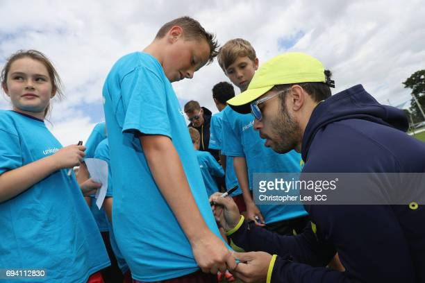 Farhaan Behardien of South Africa signs autographs for kids from a local school during the ICC Cricket For Good coaching session with South Africa...