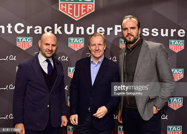 Farhad Heydari and TAG Heuer UK Manager Rob DiverWriter Robin Swithinbank pose with a guest during the Muhammad Ali tribute event at Gleason's Gym on...