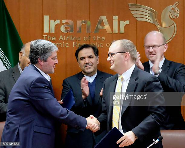 Farhad Parvaresh Chairman and Managing Director of Iran Air shakes the hand of Fletcher Barkdull Boeing regional director after signing an agreement...