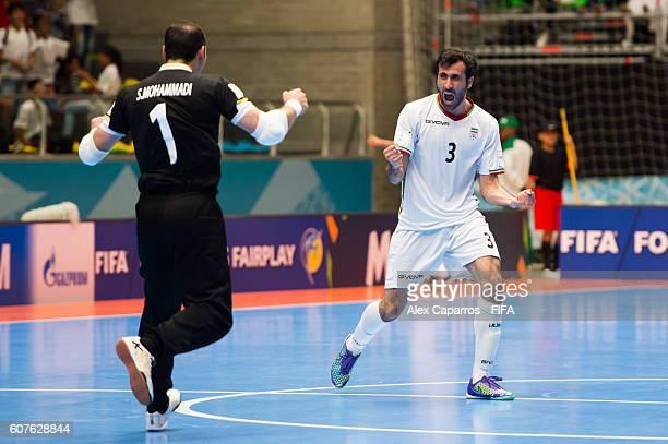 Farhad Tavakoli and Ahmad Esmaeilpour of Iran celebrate after their teammate Farhad Tavakoli scores his team's second goal during the FIFA Futsal...