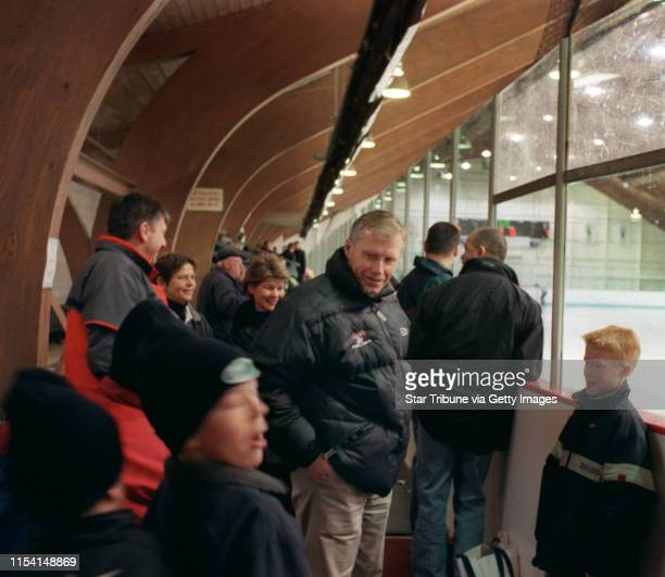 Faribault Mn 2/4/01 Andy Murray Los Angeles Kings coach at home in FaribaultLos Angeles Kings hockey coach Andy Murray center talks with his son...