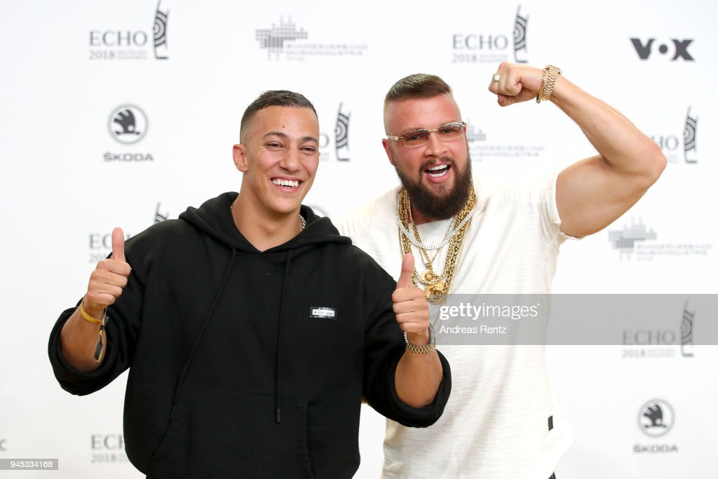 Farid Bang and Kollegah fool around as they arrive for the Echo Award at Messe Berlin on April 12, 2018 in Berlin, Germany.