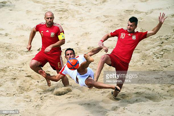 Farid Boulokbashi of Italy is challenged by Nico and Llorenc of Spain during the FIFA Beach Soccer World Cup Portugal 2015 Group C match between...