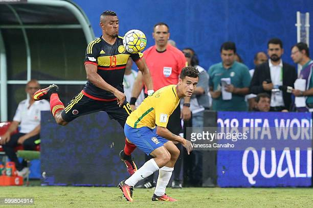 Farid Díaz of Colombia fights for the ball with Coutinho of Brazil during a match between Brazil and Colombia as part of FIFA 2018 World Cup...
