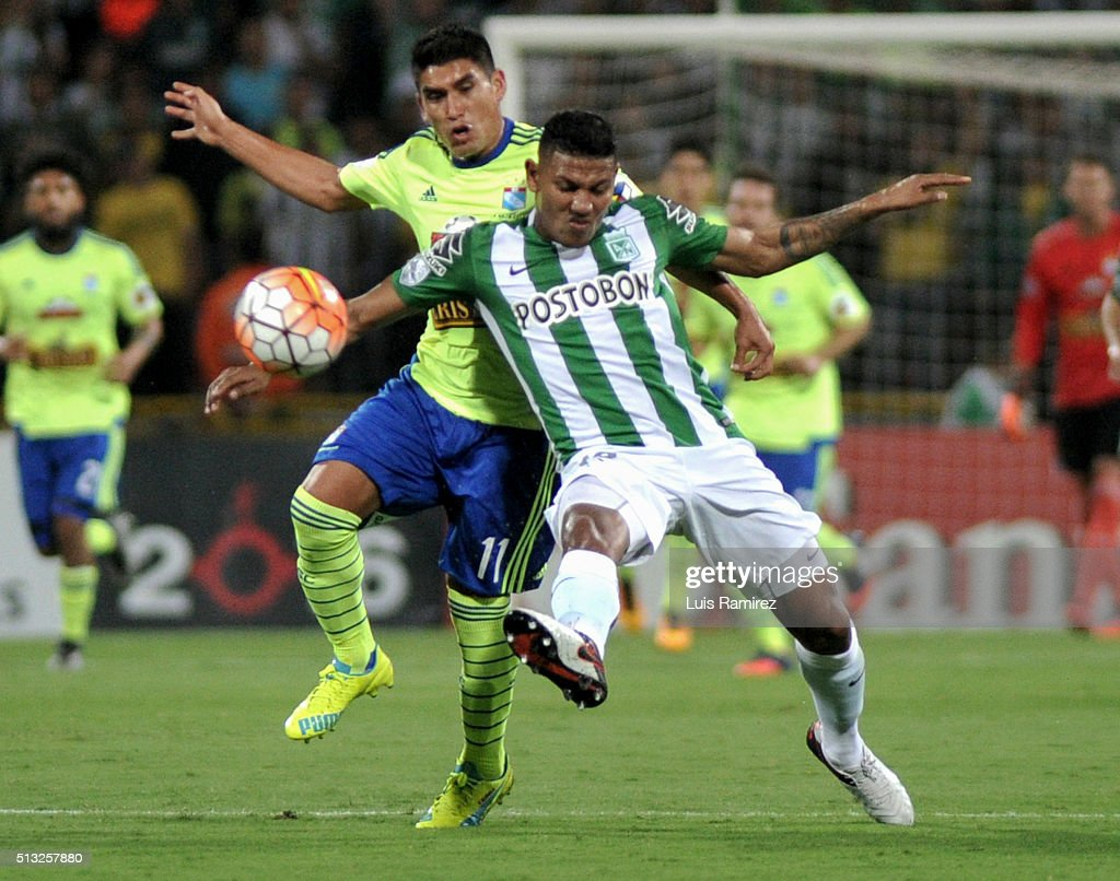 Farid Diaz player of Nacional vies for the ball with Irven Avila of Sporting Cristal during a group stage match between Atletico Nacional and Sporting Cristal as part of Copa Libertadores 2016 at Atanasio Girardot Stadium on March 01, 2016 in Medellin, Colombia.