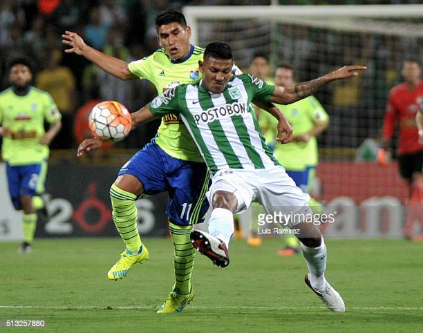 Farid Diaz player of Nacional vies for the ball with Irven Avila of Sporting Cristal during a group stage match between Atletico Nacional and...