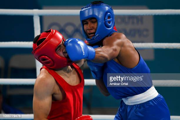 Farid Douibi of Algeria and Jancen Poutoa of Samoa compete in the Men's Middle Semifinal in the Men's Light Welter during day 10 of Buenos Aires 2018...