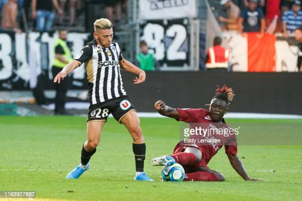Farid El Melali of Angers and Kevin N Doram of Metz during the Top 14 match between Angers and Metz on August 24 2019 in Angers France