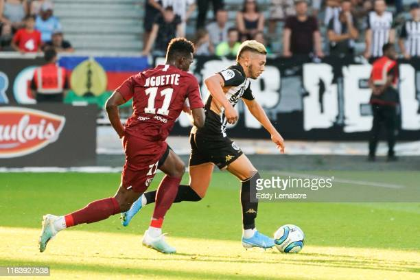 Farid El Melali of Angers and Opa Nguette of Metz during the Top 14 match between Angers and Metz on August 24 2019 in Angers France
