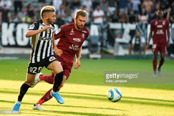 Farid El Melali of Angers and Thomas Delaine of Metz during the Top 14 match between Angers and Metz on August 24 2019 in Angers France