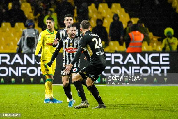 Farid EL MELALI of Angers celebrates after scoring a goal during the Ligue 1 match between Nantes and Angers at Stade de la Beaujoire on December 21...
