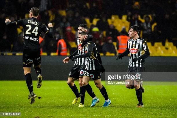 Farid EL MELALI of Angers celebrates with Rayan AIT NOURI of Angers after scoring a goal during the Ligue 1 match between Nantes and Angers at Stade...