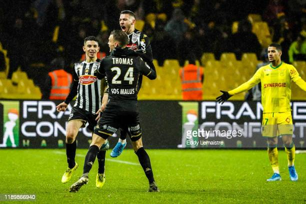 Farid EL MELALI of Angers celebrates with Romain THOMAS of Angers after scoring a goal during the Ligue 1 match between Nantes and Angers at Stade de...