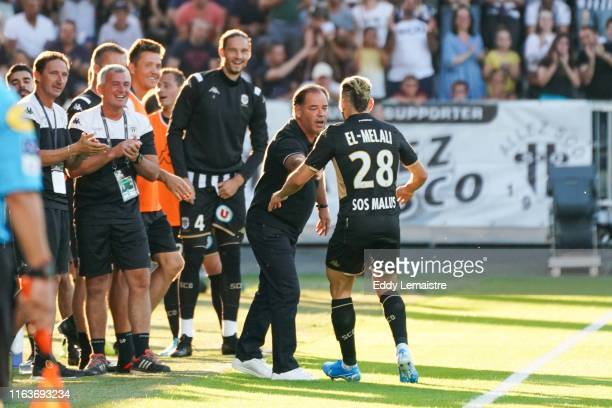 Farid El Melali of Angers celebrates with Stephane Moulin Headcoach of Angers after scoring a goal during the Top 14 match between Angers and Metz on...