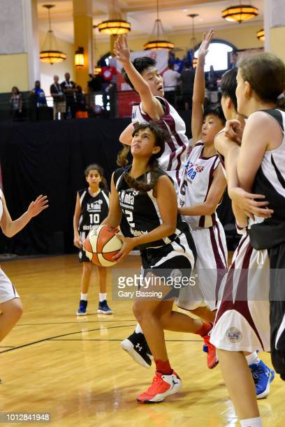 Farida Khaled Hassan Ahmed Radwan of the Africa and Middle East Girls handles the ball against the China Girls during the Jr NBA World Championship...