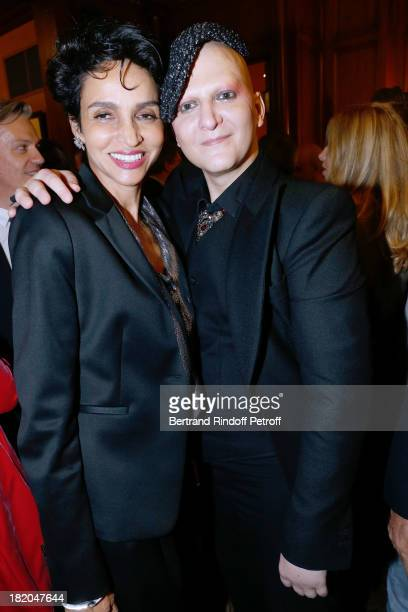 Farida Khelfa and Artist Ali Mahdavi attend the 'Opium' movie premiere held at Cinema Saint Germain in Paris on September 27 2013 in Paris France