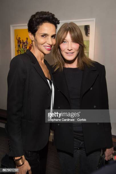 Farida Khelfa and Carla BruniSarkozy attend the Simon Bocanegra and Philippe Morillon Exhibition at la Galerie Du passage Pierre Passebon on October...