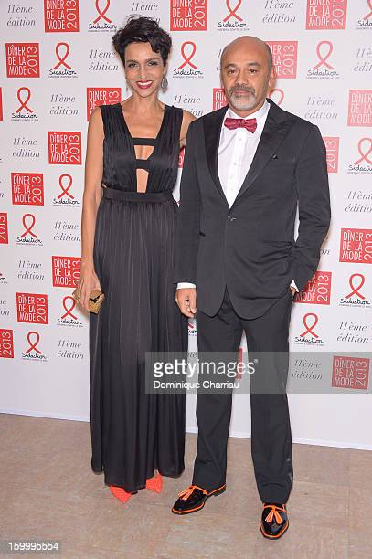 Farida Khelfa and Christian Louboutin attend the Sidaction Gala Dinner 2013 at Pavillon d'Armenonville on January 24 2013 in Paris France