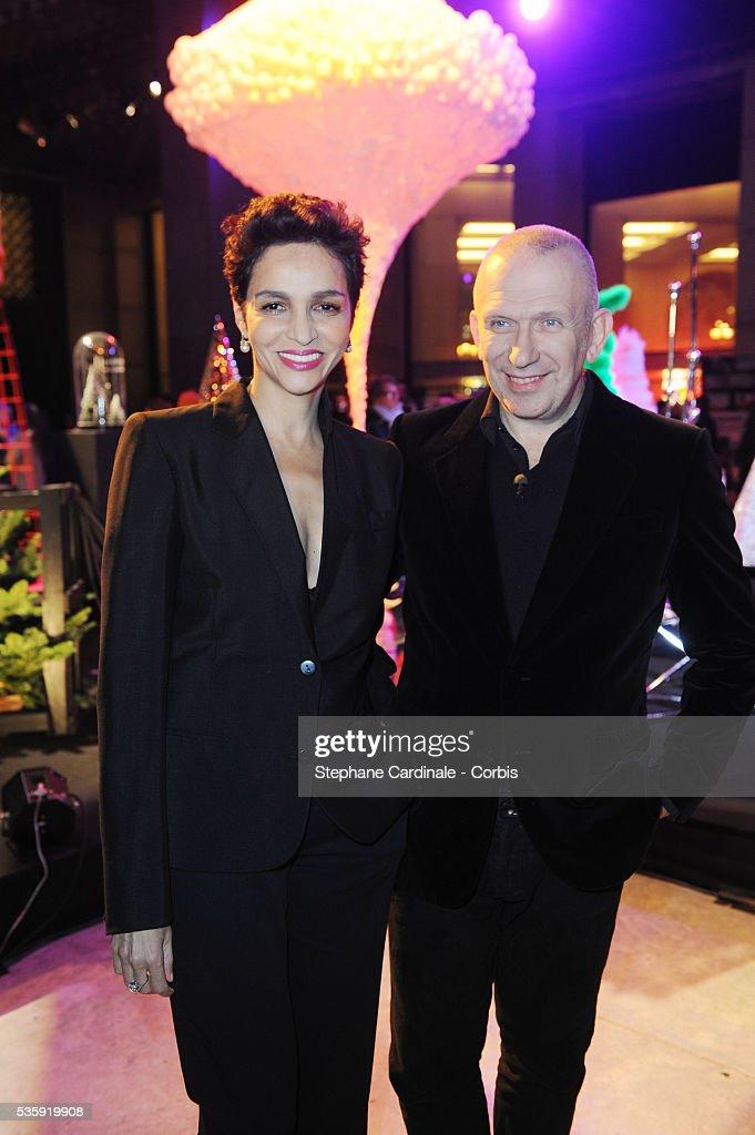 Farida Khelfa and Jean-Paul Gaultier attend 'Les Sapins de Noel des Createurs' in Paris