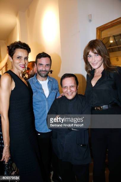 Farida Khelfa Seydoux stylist Nicolas Ghesquiere stylist Azzedine Alaia and Carla BruniSarkozy pose after the Azzedine Alaia Fashion Show as part of...