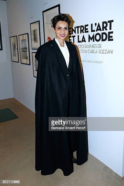 Farida Khelfa Seydoux wearing an Azzedine Alaia's Cape attends the Carla Sozzani Photo Exhibition at Azzedine Alaia Gallery on November 9 2016 in...