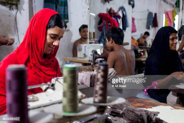 SADARGHAT DHAKA BANGLADESH Farida sews a cloth in a local garment shop in Dhaka Bangladesh World Day Against Child Labor was observed on 12 June...