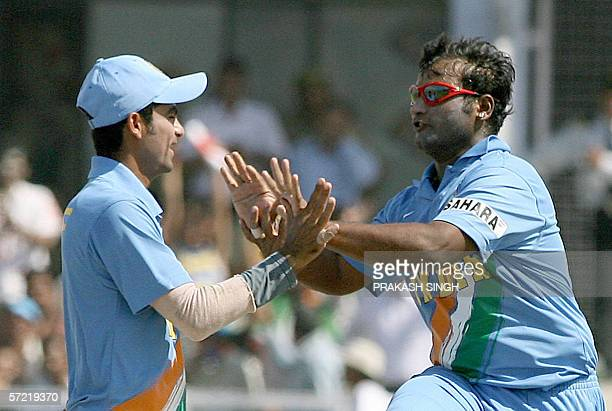 Indian cricketer Ramesh Powar celebrates with teammate Mohammad Kaif after taking the wicket of unseen England batsman Owais Shah during the second...