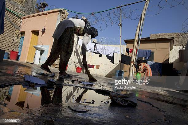 Fariha 20 sweeps the courtyard inside the women's prison October 22 2010 in MazareSharif Afghanistan According to Afghanistan's Ministry for Women...
